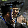"University of Colorado seniors Brian Russell, left, and Charlie Blackstock laugh together during the LEEDS School of Business graduation ceremony at the Coors Event Center on Thursday, May 10, in Boulder. For more photos of the graduation go to  <a href=""http://www.dailycamera.com"">http://www.dailycamera.com</a><br /> Jeremy Papasso/ Boulder Daily Camera"