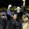 "Univeristy of Colorado seniors Alex Becker, bottom, and Brandon Hixenbaugh wave to the crowd during the LEEDS School of Business graduation ceremony at the Coors Event Center on Thursday, May 10, in Boulder. For more photos of the graduation go to  <a href=""http://www.dailycamera.com"">http://www.dailycamera.com</a><br /> Jeremy Papasso/ Boulder Daily Camera"