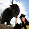 "University of Colorado senior Cristina DeWitt stands in front of the Coors Event Center before the start of the LEEDS School of Business graduation ceremony at the Coors Event Center on Thursday, May 10, in Boulder. For more photos of the graduation and a video interview with DeWitt go to  <a href=""http://www.dailycamera.com"">http://www.dailycamera.com</a><br /> Jeremy Papasso/ Boulder Daily Camera"