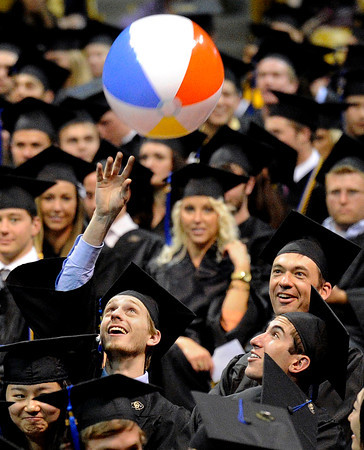 "University of Colorado senior Lawson Gackle hits a beach ball during the LEEDS School of Business graduation ceremony at the Coors Event Center on Thursday, May 10, in Boulder. For more photos of the graduation go to  <a href=""http://www.dailycamera.com"">http://www.dailycamera.com</a><br /> Jeremy Papasso/ Boulder Daily Camera"
