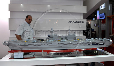 A man looks to a italian manufactured aircraft carrier at the Latin America Aero and Defence (LAAD) trade show for the defence and security industry in Latin America, Rio de Janeiro, Brazil, April 14, 2011. (Austral Foto/Renzo Gostoli)