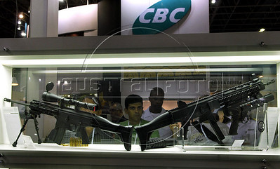 People look at automatic weapons displayed at the Latin America Aero and Defence (LAAD) trade show for the defence and security industry in Latin America, Rio de Janeiro, Brazil, April 14, 2011. (Austral Foto/Renzo Gostoli)