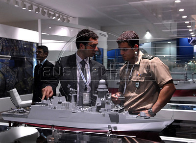 Men look at a italian manufactured navy at the Latin America Aero and Defence (LAAD) trade show for the defence and security industry in Latin America, Rio de Janeiro, Brazil, April 14, 2011. (Austral Foto/Renzo Gostoli)