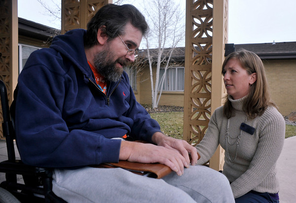 INEWS117-LONG_TERM_CARE.JPG Social worker Becky Lane-Ramsey, right, says good-bye to Cliff Seigneur as he moves out of North Start Community long-term care facility in west Denver on Nov. 29, 2010. Seigneur, who has multiple sclerosis, moved into North Star in late 2009 after he was unable to stay in his Paonia, Colo. home. He spent six months working with advocacy group Atlantis Community before finding an accessible apartment in Golden. <br /> (JOE MAHONEY/I-NEWS)