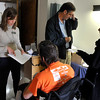 INEWS111-LONG_TERM_CARE.JPG Social worker Becky Lane-Ramsey, left, reviews discharge information with Cliff Seigneur, a former Colorado assistant attorney general who has multiple sclerosis, as he moves out of the nursing home in west Denver on Nov. 29, 2010. Seigneur spent six months working with a Denver-area advocacy group, Atlantis Community, to find an accessible apartment and home health care services. Atlantis staff Larry Williams, second from left, and Mark Cunningham help pack Seigneur's possessions. (JOE MAHONEY/I-NEWS)