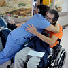 INEWS115-LONG_TERM_CARE.JPG Cliff Seigneur, a former Colorado assistant attorney general, gets a hug as he leaves the North Star Community long-term care facility in west Denver on Nov. 29, 2010. Seigneur, who has multiple sclerosis,  moved into North Star in late 2009 after he was unable to stay in his Paonia, Colo. home. He spent six months working with advocacy group Atlantis Community before finding an accessible apartment in Golden. (JOE MAHONEY/I-NEWS)