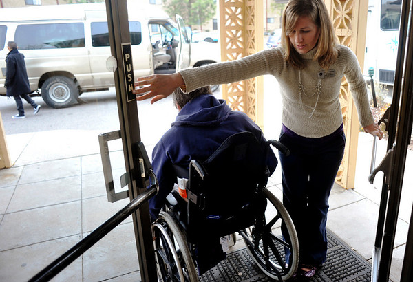 INEWS116-LONG_TERM_CARE.JPG Social worker Becky Lane-Ramsey, right, holds open a door for Cliff Seigneur as he moves out of North Start Community long-term care facility in west Denver on Nov. 29, 2010. Seigneur, who has multiple sclerosis, moved into North Star in late 2009 after he was unable to stay in his Paonia, Colo. home. He spent six months working with advocacy group Atlantis Community before finding an accessible apartment in Golden. <br /> (JOE MAHONEY/I-NEWS)