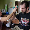 INEWS103-LONG_TERM_CARE.JPG Occupational therapist Holly Foor, left, works with Cliff Seigneur, 48, who has multiple sclerosis, at the North Star Community long-term care facility in west Denver on Oct. 11, 2010. A former Colorado assistant attorney general, Seigneur spent a year living at North Star, but wanted to live in his own apartment to finish a novel.<br /> (JOE MAHONEY/I-NEWS)