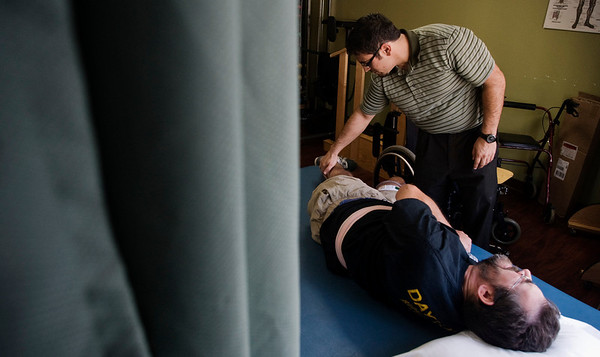 INEWS106-LONG_TERM_CARE.JPG Physical therapist Vaughn Villarreal, right, works with Cliff Seigneur, 48, who has multiple sclerosis, at the North Star Community long-term care facility in west Denver on Oct. 11, 2010. Seigneur connected with a Denver-based disabled rights group to help him find a way to live independently and then spent six months securing an apartment and home healthcare services. (JOE MAHONEY/I-NEWS)