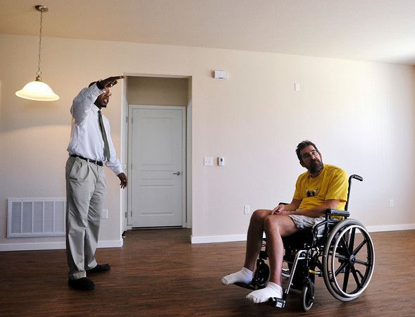 INEWS109-LONG_TERM_CARE.JPG Golden Pointe apartments assistant manager Keith Lewis, left, talks to Cliff Seigneur, about the features of an apartment at the Golden, Colo., on Sept. 7, 2010 complex where Seigneur was seeking a wheelchair accessible unit. <br /> (JOE MAHONEY/I-NEWS)