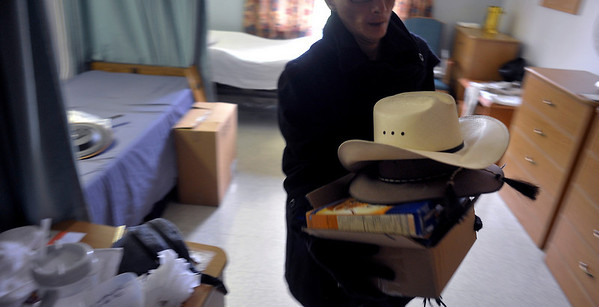 INEWS113-LONG_TERM_CARE.JPG Atlantis Community staffer Mark Cunningham carries a cowboy hat with other items of Cliff Seigneur, a former Colorado assistant attorney general,  as Seigneur moves out of the North Star Community long-term care facility in west Denver on Nov. 29, 2010. Seigneur spent six months working with a Denver-area advocacy group, Atlantis Community, to find an accessible apartment and home health care services. (JOE MAHONEY/I-NEWS)