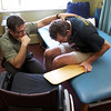 INEWS105-LONG_TERM_CARE.JPG Physical therapist Vaughn Villarreal, left, works with Cliff Seigneur, 48, who has multiple sclerosis, at the North Star Community long-term care facility in west Denver on Oct. 11, 2010. Seigneur has high praise for the facility and staff, but he wanted to move into his own apartment to finish a novel. Seigneur connected with a Denver-based disabled rights group to help him find a way to live independently and then spent six months securing an apartment and home healthcare services. (JOE MAHONEY/I-NEWS)