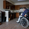 INEWS120-LONG_TERM_CARE.JPG On the first day in his new apartment in Golden, Colo., Cliff Seigneur,48, looks at his stereo, which had been in storage for the year he spent in a Denver-area nursing home. Seigneur connected with a Denver-based disabled rights group to help him find a way to live independently and then spent six months securing an apartment and home healthcare services. (JOE MAHONEY/I-NEWS)