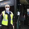 LRTA bus driver Ellen Patnaude, at the Gallagher Transportation Center in Lowell. At right in the bus is fellow driver Kenny Clough. (SUN/Julia Malakie)