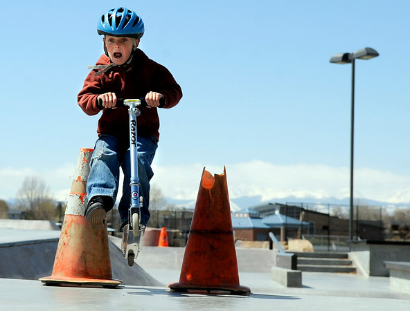 """Gabe Stewart, 6, of Aurora, gets some air with his scooter on Friday, April 15, at the Lafayette Skatepark which is located adjacent to the Bob L. Burger Recreation Center at 111 W. Baseline Road in Lafayette. For more photos and video of the skatepark go to  <a href=""""http://www.dailycamera.com"""">http://www.dailycamera.com</a><br /> Jeremy Papasso/ Camera"""