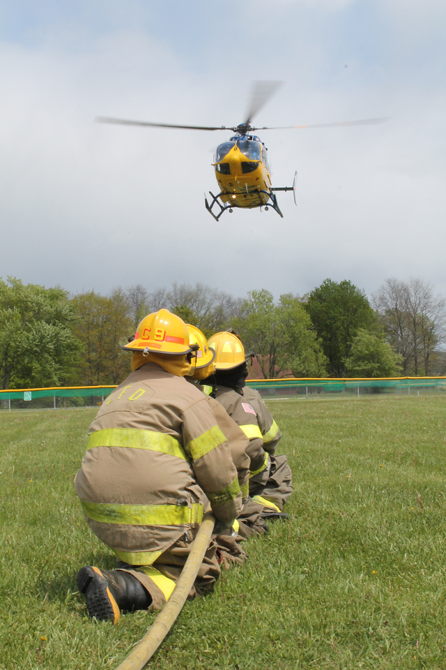 LAWRENCE PANTAGES / GAZETTE A Metro Health Life Flight helicopter based in Lorain County visited the Lafayette Township Fire Department on Sunday during a three-hour community open house. Fire department workers and family members were invited to tour the facilities and see the helicopter along with community members during the event.