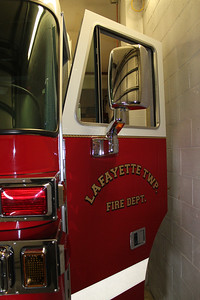 LAWRENCE PANTAGES / GAZETTE The close quarters of the Lafayette Township Fire Department station's vehicles and walls of the building at 6776 Wedgewood Road was shown Sunday during a three-hour community open house. The station was built in the 1950s and voters will be asked to approve a levy on Aug. 2 for construction of a new facility.