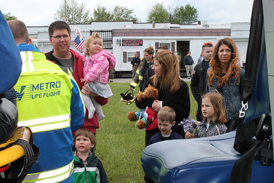 LAWRENCE PANTAGES / GAZETTE Families of Lafayette Township Fire & Rescue Department workers, along with residents of the township and guests, were welcome to tour the station and have pictures taken with a Metro Life Flight helicopter Sunday during a three-hour open house.