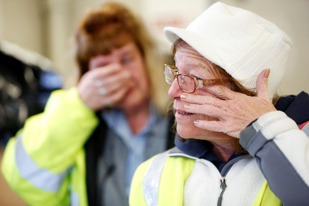 . Toll collector Robin Coutsonikas, front, and senior toll collector Lynne Miller, back, tear up saying goodbye as Coutsonikas leaves after her final shift at the Mass Pike Exit 1 toll plaza.  At approximately 10PM, the cash tolls will be closed for good and the demolition of the entire West Stockbridge toll plaza will begin. Friday, October 28, 2016. Stephanie Zollshan � The Berkshire Eagle | photos.berkshireeagle.com