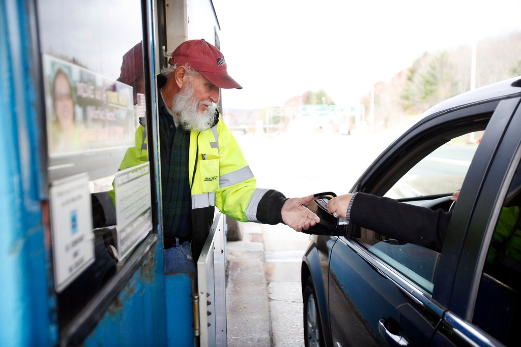 . Joe Kalisz, who has worked at the Mass Pike Exit 1 toll plaza for 2 years, collects tickets at the West Stockbridge facility. At approximately 10PM, the cash tolls will be closed for good and the demolition of the entire toll plaza will begin. Friday, October 28, 2016. Stephanie Zollshan � The Berkshire Eagle | photos.berkshireeagle.com