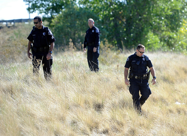 """Police search for a missing girl named Jessica Ridgeway on Monday, Oct. 8, on the side of highway 36 near the Flatirons Crossing exit in Broomfield. For more photos and video of the search go to  <a href=""""http://www.dailycamera.com"""">http://www.dailycamera.com</a><br /> Jeremy Papasso/ Camera"""