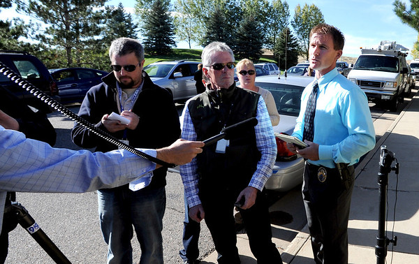 Westminster police spokesman Trevor Materasso, right, answers questions from the media.<br /> Officers search cars and question residents in the Andrew Dr. neighborhood in Superior Sunday afternoon.<br /> The search for missing 10-year-old Jessica Ridgeway of Westminster has shifted to Superior this afternoon after a resident reported the discovery of a backpack with a water bottle that has the girl's name written on it. <br /> Cliff Grassmick  / October 7, 2012