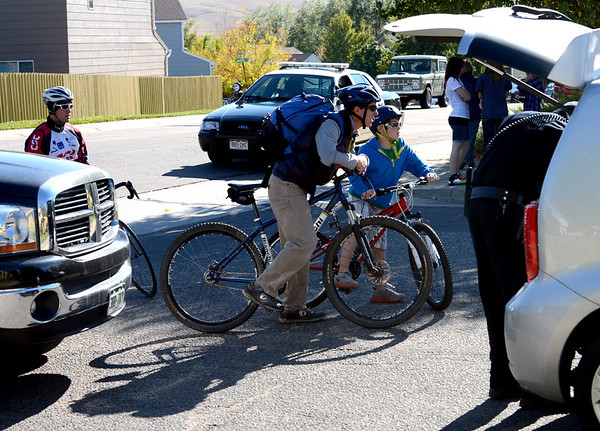 Cyclists wait to be questioned before leaving the neighborhood.<br /> Officers search cars and question residents in the Andrew Dr. neighborhood in Superior Sunday afternoon.<br /> The search for missing 10-year-old Jessica Ridgeway of Westminster has shifted to Superior this afternoon after a resident reported the discovery of a backpack with a water bottle that has the girl's name written on it. <br /> Cliff Grassmick  / October 7, 2012
