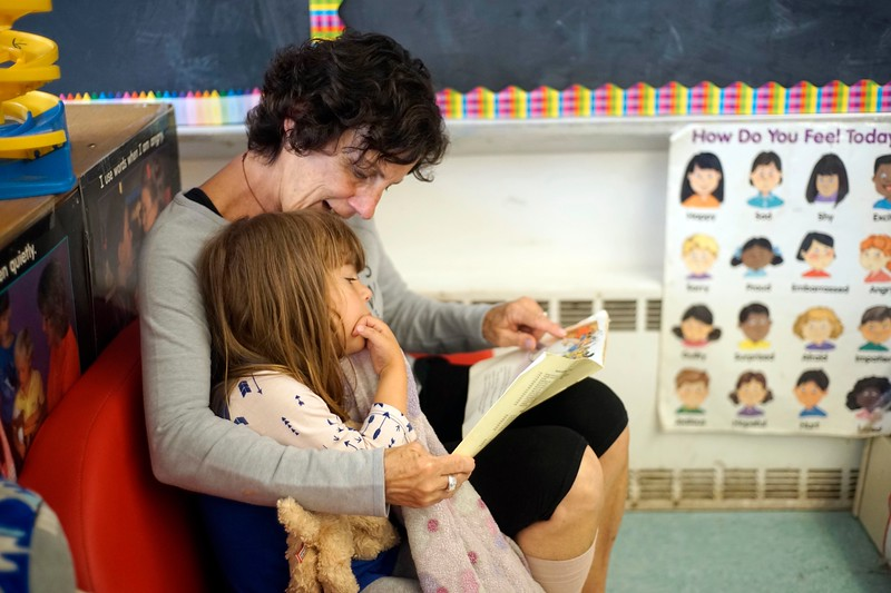 BEN GARVER — THE BERKSHIRE EAGLE<br /> Bev McDermott reads to a student at Berkshire county Head Start. Berkshire County Head Start is one of the agencies participating in a landmark study by the Harvard Graduate School of Education on learning environments serving 3 and 4 year olds in Massachusetts.