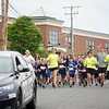 BEN GARVER — THE BERKSHIRE EAGLE<br /> Students from the Lee Elementary School had a police escorted run with the cruisers and officers running with the students from the school through town to the athletic fields where medals are provided by the Lee Police association.