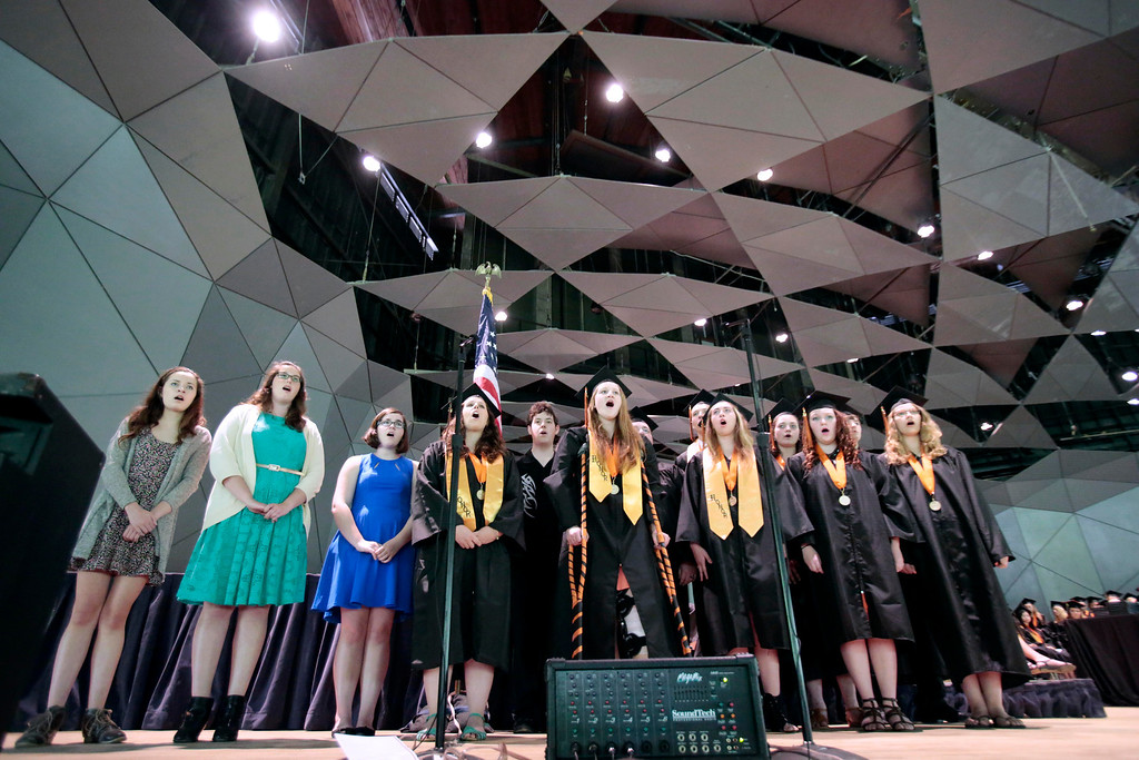 . The chorus performs the song \'For Good\' from the show Wicked at the Lee High School gradation ceremony at Tanglewood in Lenox. Saturday, June 7, 2014. Stephanie Zollshan / Berkshire Eagle Staff / photos.berkshireeagle.com