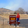 "The Lefthand Canyon Fire burns on the hills in the background of this fire danger sign in north Boulder.<br /> For a videos of the fire, go to  <a href=""http://www.dailycamera.com"">http://www.dailycamera.com</a>.<br /> Cliff Grassmick/ March 11, 2011"