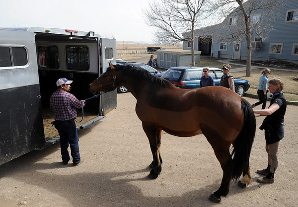 """Rubin Trinidad, left, and Jenny Baldwin, load up a horse at Autumn Hill Equestrian Center, during the evacuation because of the Lefthand Canyon Fire on Friday.<br /> For a videos of the fire, go to  <a href=""""http://www.dailycamera.com"""">http://www.dailycamera.com</a>.<br /> Cliff Grassmick/ March 11, 2011"""