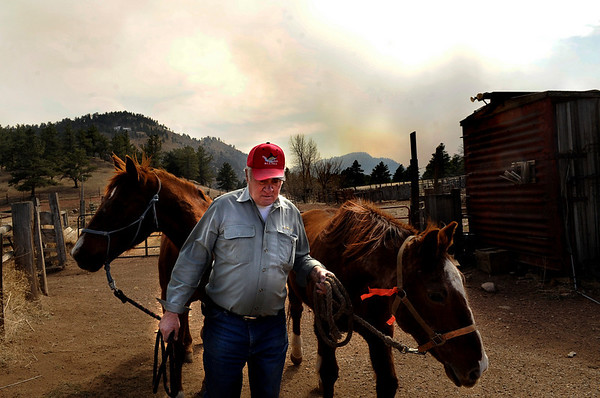 Duane Weibel, 68, of Boulder, moves his horses into a trailer at the Heil Valley Ranch while evacuating on Friday, March 11, due to the Lefthand Canyon wildfire.<br /> Jeremy Papasso/ Camera