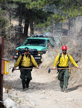 Firefighters exit Forest Road 286 at their initial staging area at Lefthand Canyon Drive during the early stages of the Lefthand Canyon Fire on Friday.<br /> Photo by Marty Caivano/March 11, 2011