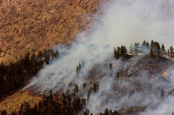 Flames runs through the hillside on the south side of the  Lefthand Canyon Fire near Boulder Colorado on Friday March 11, 2011<br /> Photo by Paul Aiken / The Boulder Camera