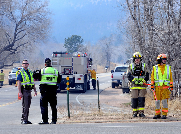 """Boulder County Sheriff's deputies and firefighters staff Lefthand Canyon Road off of Highway 36.<br /> For a videos of the fire, go to  <a href=""""http://www.dailycamera.com"""">http://www.dailycamera.com</a>.<br /> Cliff Grassmick/ March 11, 2011"""