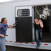 "Petra Verlimont, left, and Kristen Reber, of Autumn Hill Equestrian Center, finish loading up a horse to be taken to the Boulder County Fairgrounds in Longmont as part of the evacuation of the Lefthand Fire north of Boulder.<br /> For a videos of the fire, go to  <a href=""http://www.dailycamera.com"">http://www.dailycamera.com</a>.<br /> Cliff Grassmick/ March 11, 2011"