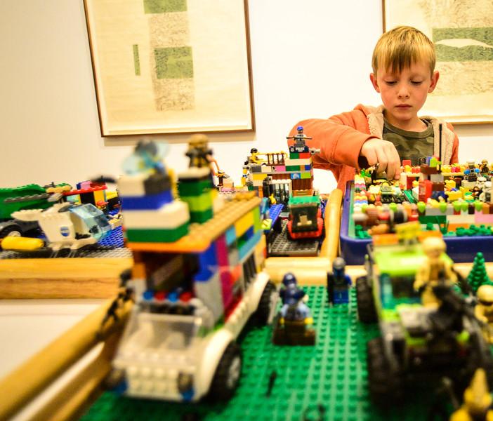 """KRISTOPHER RADDER — BRATTLEBORO REFORMER<br /> Ryder Suponski, 7, assembles his Lego creation he called """"Lego World Wars."""""""