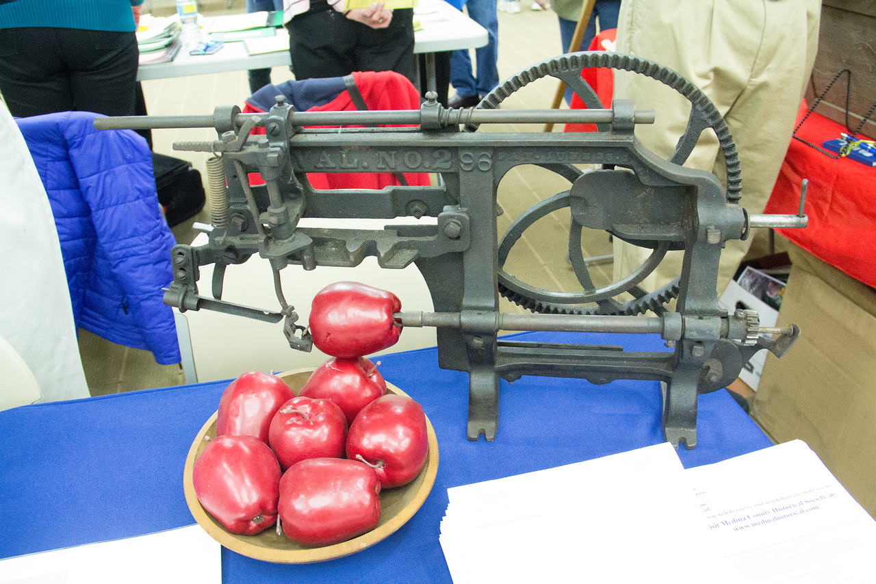 """ALEC SMITH / GAZETTE An apple peeling machine was on display Saturday during a """"Preserving Medina County History"""" event held at the Medina County District Library."""