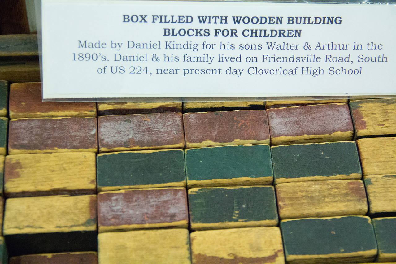 """ALEC SMITH / GAZETTE Toy wooden blocks for children from the 1890s were on display Saturday during a """"Preserving Medina County History"""" event held at the Medina County District Library."""