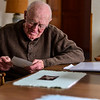 KRISTOPHER RADDER — BRATTLEBORO REFORMER<br /> Jonathan Tobey, a man with dementia, looks over photos of his past on Jan. 24, 2019.