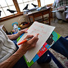 KRISTOPHER RADDER — BRATTLEBORO REFORMER<br /> Katie Tobey writes a note for Richard Pomfrey before she leaves to go to a yoga class so she can have some time for herself.