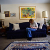 KRISTOPHER RADDER — BRATTLEBORO REFORMER<br /> Katie Tobey sits on the couch to take a minute for herself as her father battles with dementia on Jan. 31, 2019.