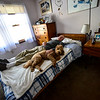 KRISTOPHER RADDER — BRATTLEBORO REFORMER<br /> Jonathan Tobey lies in his bed, as the family dog, Gracie, joins him as he tries to get some rest on March 1, 2019.