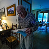 KRISTOPHER RADDER — BRATTLEBORO REFORMER<br /> Jonathan Tobey, a man with dementia, flips through a book as he cycles through three different actions.