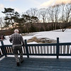 KRISTOPHER RADDER — BRATTLEBORO REFORMER<br /> Jonathan Tobey, a man with dementia, goes outside to look at the feed he put out for the turkeys during a cold day on Feb. 5, 2019. He went out five different times in a cycle that he was in, between reading a book, looking at his plants and looking for the turkeys.