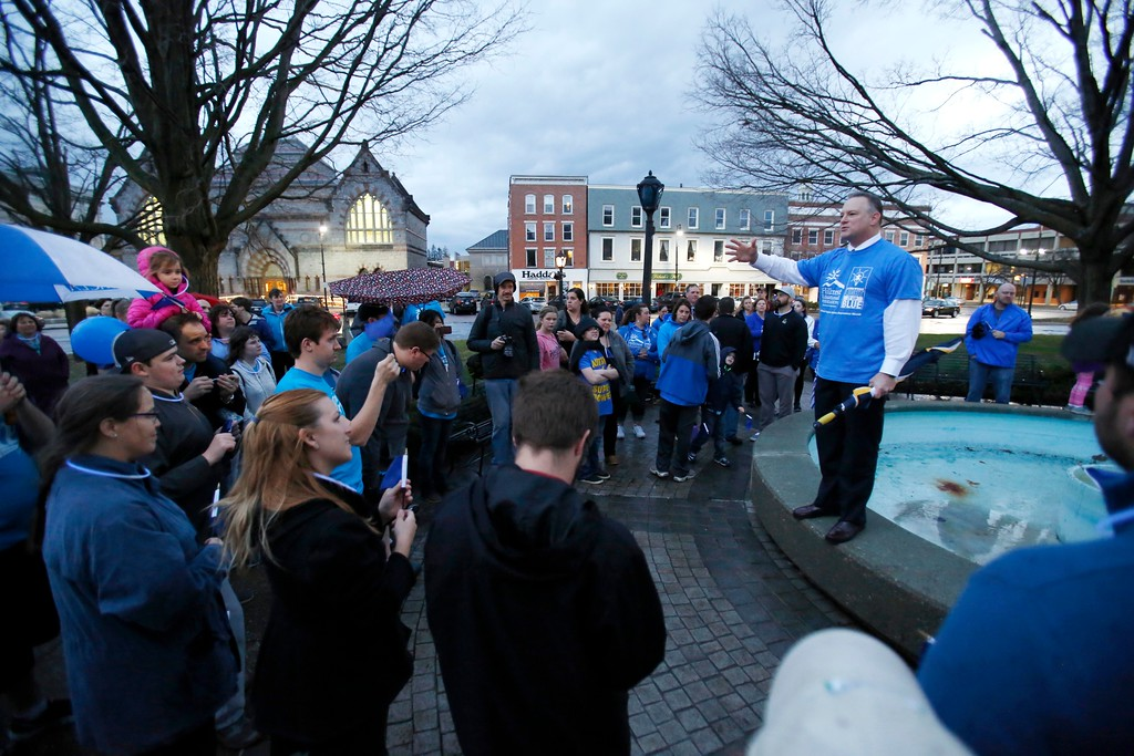 . Hillcrest Educational Centers\' Executive Director Shaun Cusson speaks at Park Square in Pittsfield as part of the global \'Light It Up Blue\' event to raise awareness for Autism. Though the lights at the park never turned on, many gathered to show their support. Friday, April 1, 2016. Stephanie Zollshan � The Berkshire Eagle | photos.berkshireeagle.com
