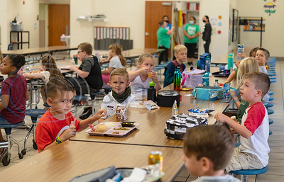 Second graders sit one to two seats apart in the cafeteria during lunch on the first day of school at College Street Elementary School in Lindale on Wednesday, Aug. 19, 2020. The school is following Gov. Abbott's order that children age 10 and under do not have to wear face masks. The school limiting cafeteria use to 50 percent capacity.