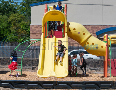 First graders play during recess on the first day of school at College Street Elementary School in Lindale on Wednesday, Aug. 19, 2020. The school is following Gov. Abbott's order that children age 10 and under do not have to wear face masks. The school is limiting the amount of students outside together at recess as well as in the cafeteria for lunch.