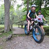 Mary Hannah Parkman, right, founder of the Berkshire Little Bellas mentoring on mountain bikes chapter, watches Hannah Manzolini, 10, successfully ride over a bridge in Pittsfield State Forest.